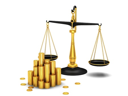 overbalance: Gold coins and scales on white background Stock Photo