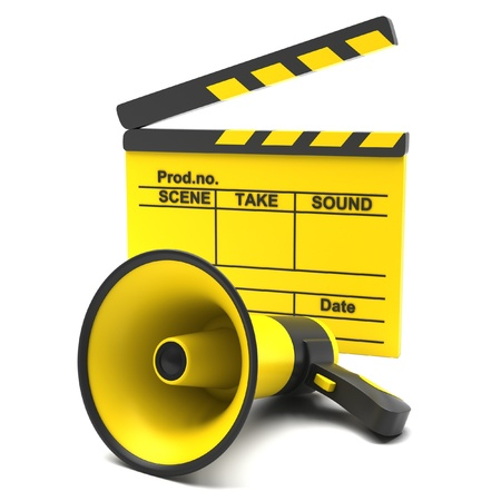 Yellow movie clapper and megaphone on a white background photo