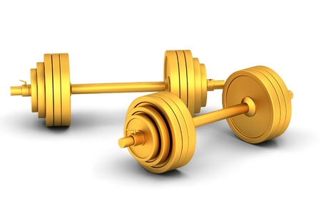 Gold dumbbells on a white background photo
