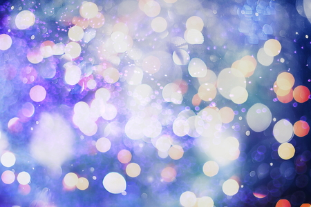 Abstract Festive background. Glitter vintage lights background with lights defocused. Christmas and New Year feast bokeh background with copyspace. 免版税图像