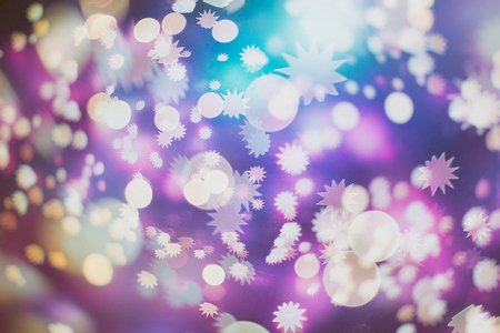 Abstract Festive background. Glitter vintage lights background with lights defocused. Christmas and New Year feast bokeh background with copyspace. Stock Photo