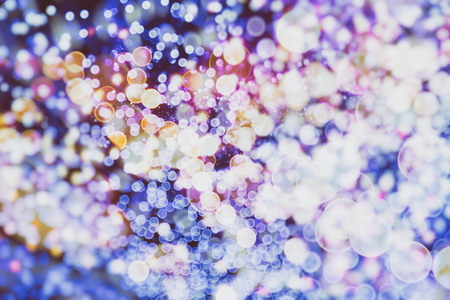 Abstract Festive background. Glitter vintage lights background with lights defocused. Christmas and New Year feast bokeh background with copyspace. 版權商用圖片