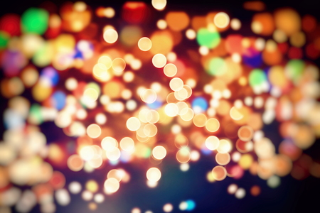 abstract background of sparkles and circles of the lit lit celebrations display.