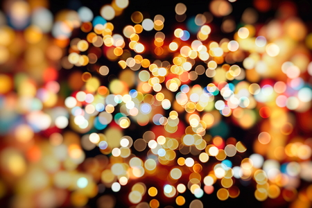christmas lights display: abstract blurred and silver glittering shine bulbs lights background: blur of Christmas wallpaper decorations concept.holiday festival backdrop: sparkle circle lit celebrations display.