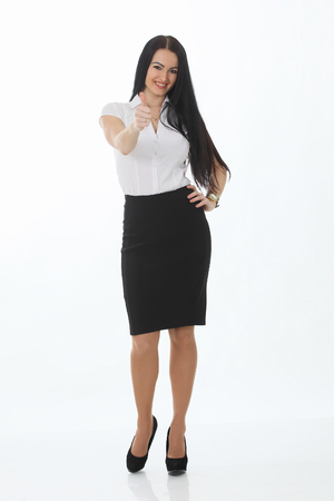 looking away from camera: Full length portrait of a cheerful businesswoman pointing finger away camera. Isolated on a white background. Looking at camera