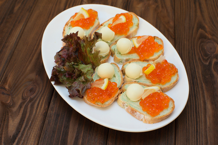 celebratory: Sandwiches with butter and red salmon caviar. Celebratory appetizer