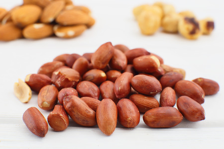 earthnuts: Nuts and dried fruits on wooden background