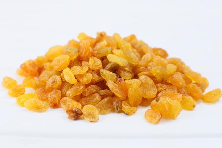sultanas: Yellow sultanas raisins isolated on white background cutout.