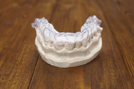 Close-up individual tooth tray Orthodontic dental theme. Invisible braces Stock Photo