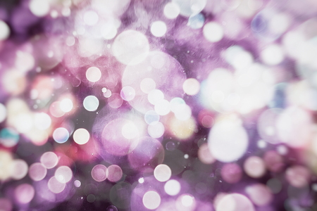 Abstract Festive background. Glitter vintage lights background with lights defocused.