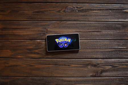 screenshot: Vinnitsa, Ukraine. - August 12: Smartphone on a wooden board with Pokemon Go logo, August 12, 2016 in Vinnitsa, Ukraine