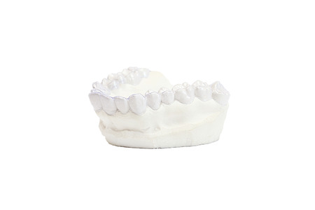 orthodontic: Close-up individual tooth tray Orthodontic dental theme. Invisible braces Stock Photo
