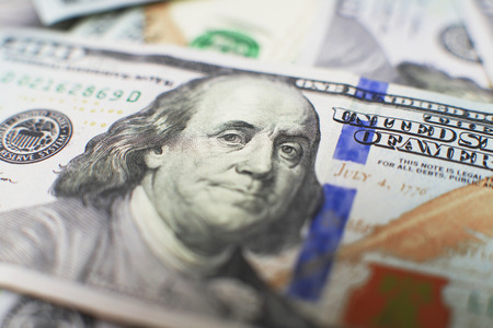 fake money: A stack of money. Heap of one hundred dollar bills on money background. Fake money. Shallow depth of field. Selective focus. Stock Photo