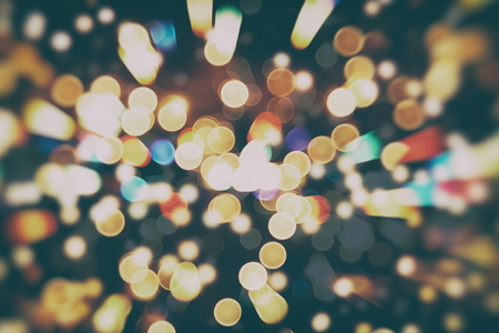 bstract: Festive Background With Natural Bokeh And Bright Golden Lights. Vintage Magic Background With Color