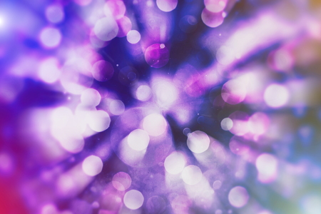 abstract blurred of blue and silver glittering shine bulbs background: blur of Christmas wallpaper decorations concept.xmas holiday festival backdrop: sparkle circle lit celebrations display.