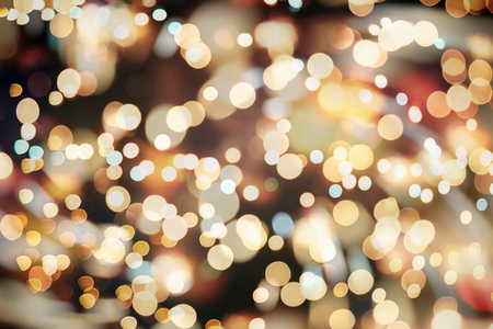 glittering shine bulbs lights background: blur of Christmas wallpaper decorations concept.holiday festival backdrop: sparkle circle lit celebrations display.