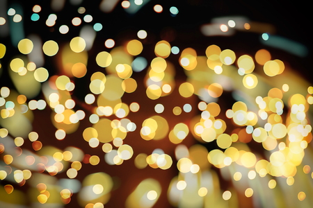 Glittering shine bulbs lights background blur of Christmas wallpaper decorations concept.