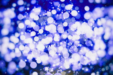 blur of Christmas wallpaper decorations concept.xmas holiday festival backdrop: sparkle circle lit celebrations display.