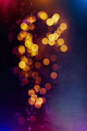 abstract background of blurred yellow lights with bokeh effect