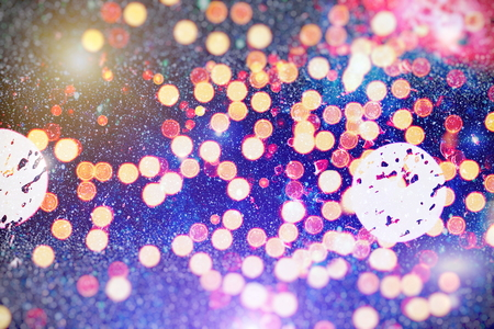 abstract blurred of blue and silver glittering shine bulbs lights background:blur of Christmas wallpaper decorations concept.xmas holiday festival backdrop:sparkle circle lit celebrations display. Stock Photo
