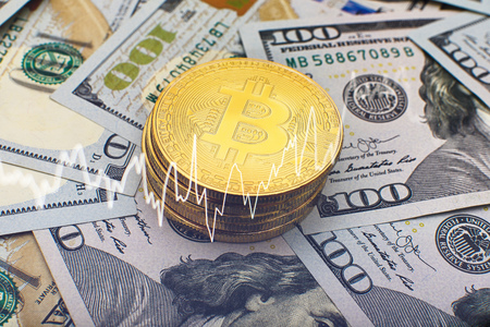 Bitcoin currency and dollar. BTC market symbol cryptocurrency rising above the united states dollar. Gold metal bitcoin on top of paper currency. Copy space for text and wording. Stock fotó