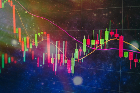 Abstract financial trading graphs and digital number on monitor. Background of gold and blue digital chart to represent stock market trend.