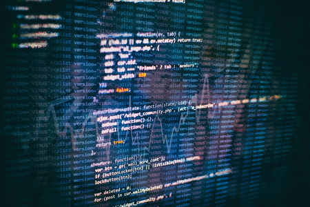 Website HTML Code on the Laptop Display Closeup Photo. Desktop PC monitor photo. 版權商用圖片