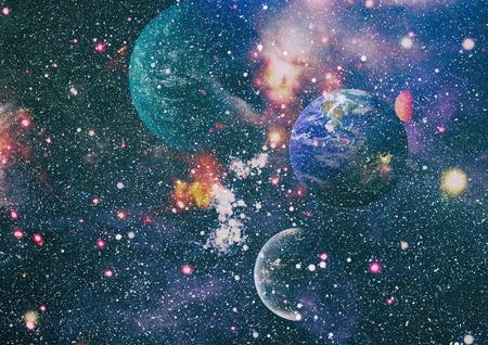 Earth, galaxy and sun.