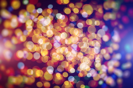 Blurred bokeh light background, Christmas and New Year holidays background Standard-Bild