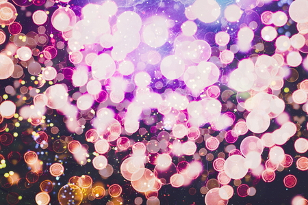 Blurred bokeh light background, Christmas and New Year holidays background 写真素材