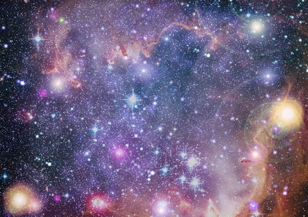 Star field and nebula in deep space many light years far from planet Earth.