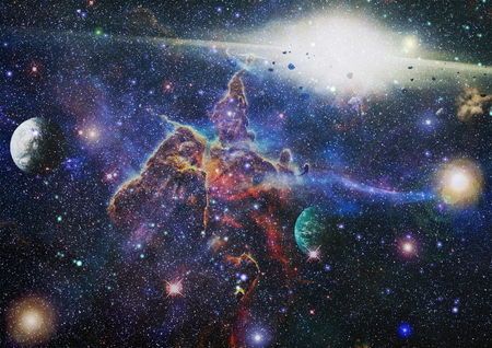 Star field and nebula in deep space many light years far from planet Earth. Imagens