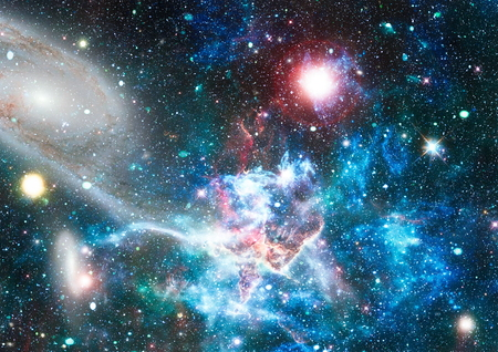 Star field and nebula in deep space many light years far from planet Earth. 写真素材