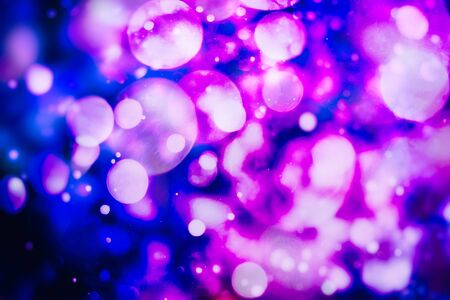 Colored abstract blurred light glitter background layout design can be use for background concept or festival background. Bokeh with multi colors