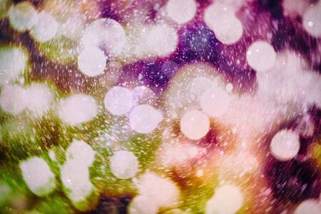 Christmas bokeh glowing Background. Glowing holiday abstract defocused colorful backdrop. Bright vivid blurred colourful new year holiday bokeh