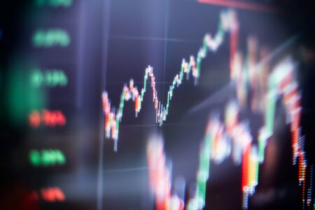 Abstract financial trading graphs on monitor. Background with currency bars and candles Stock Photo