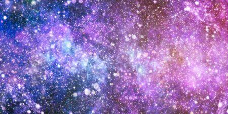 Space view of a shiny blue nebula.