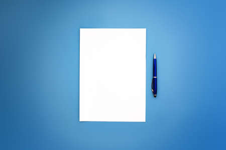 Wide image of A4 white sheet and blue pens