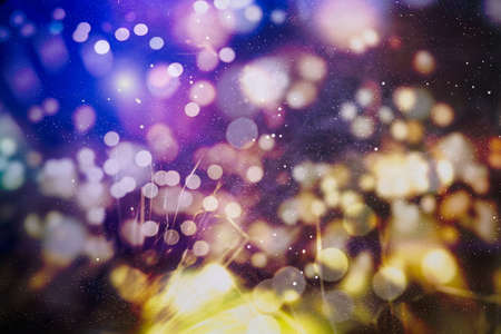 Christmas lights. Gold Holiday New year Abstract Glitter Defocused Background With Blinking Stars and sparks. Banque d'images