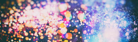 Abstract Festive background. Glitter vintage lights background with lights defocused. Christmas and New Year feast bokeh background with copyspace. Banque d'images