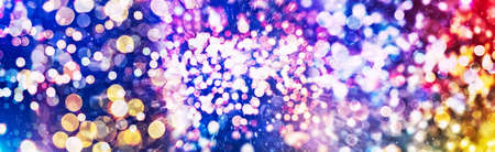 Abstract Festive background. Glitter vintage lights background with lights defocused. Christmas and New Year feast bokeh background with copyspace. Фото со стока