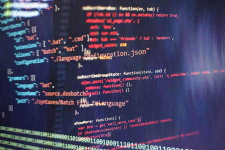 Abstract computer script code. Programming code screen of software developer. Software Programming Work Time.