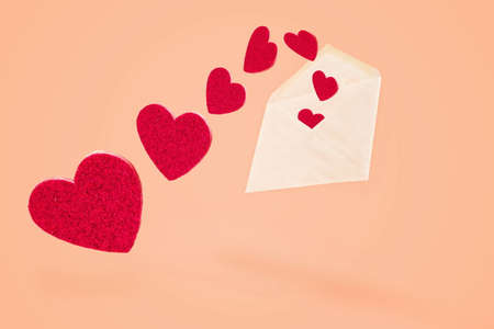 White envelope with flying out hearts, valentine holiday concept