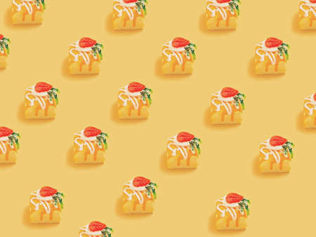 Minimal concept.Trendy Candy pattern made with various candy on bright light yellow background.