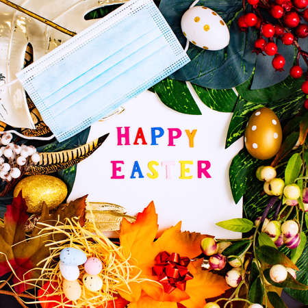 Happy Easter. Congratulatory easter background. Easter eggs and flowers. Flat lay. Nature concept.