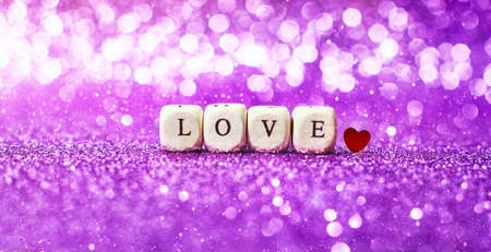 Lettering Love bright glitter lights bokeh background.
