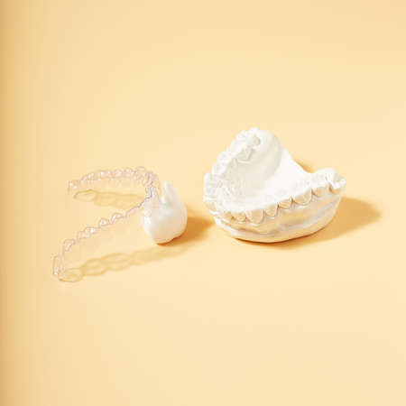 Orthodontic dental theme on yellow background. Transparent invisible dental aligners or braces applicable for an orthodontic dental treatment