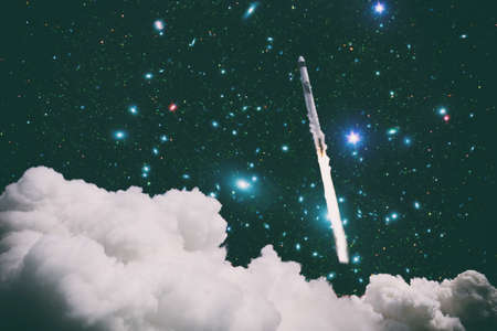 Rockets launch into space on the starry sky. Rocket starts into space concept.