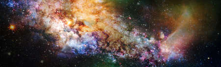 Stars of a planet and galaxy in a free space. Colored nebula and open cluster of stars in the universe. 版權商用圖片
