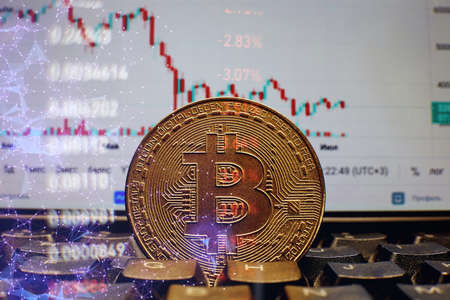 Gold bitcoins with Candle stick graph chart and digital background. Golden coin with icon letter B. Mining or blockchain technology